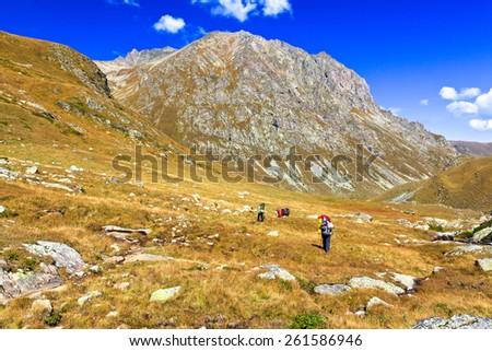 Mountain landscape. Picture was taken during trekking hike in  scenic mountains of north Caucasus at autumn, Arkhiz region, Abishira-Ahuba range, Karachay-Cherkessia, Russia - stock photo