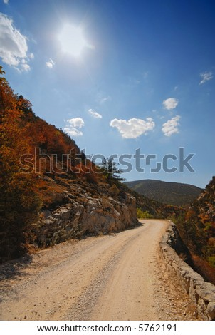 Mountain Landscape,  Sun in the Blue Sky and Road. Crimea. Ukraine. Europe.