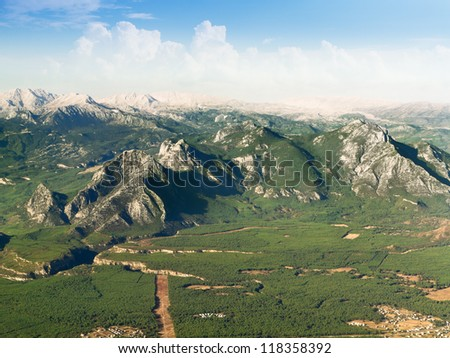 mountain landscape view from plane - stock photo
