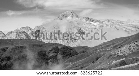 mountain landscape wallpaper green grass black and white photo of the mountains in the fog - stock photo