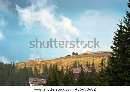 Mountain landscape with a rainbow - stock photo