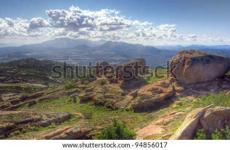 Mountain landscape with boulders and clouds