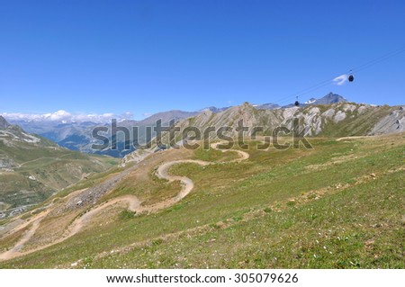 mountain landscape with cable car in summer - ski resort Tignes- - stock photo
