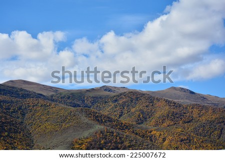 Mountain landscape with dramatic sky - stock photo