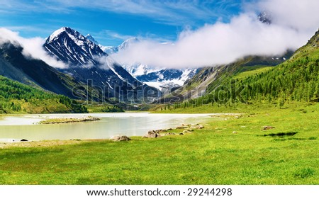 Mountain landscape with lake and forest - stock photo