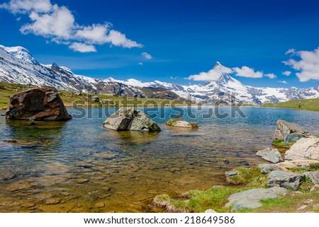 Mountain landscape with lake and Matterhorn mountain  - stock photo