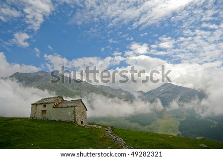 Mountain Landscape with small abandoned house. Italian Alps. - stock photo