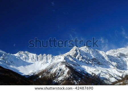 Mountain landscape with snow and moon - stock photo