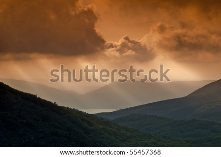 Mountain landscape with view of dramatic sunset - stock photo