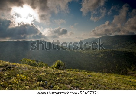 Mountain landscape with view of dramatic sunset