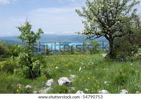 Mountain landscape with view of lake - stock photo