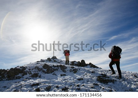 Mountain mark, path  and climbers