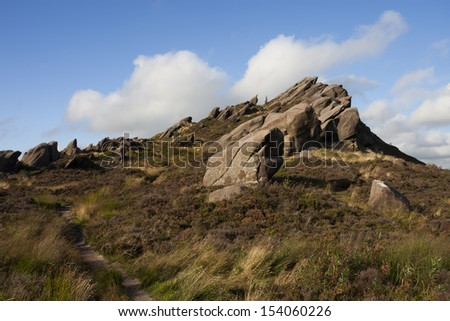 mountain meadow scene with rocks in the roaches, peak district - stock photo