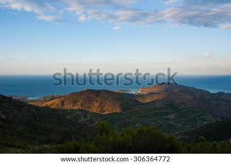 Mountain near the sea under cloudy sky - stock photo