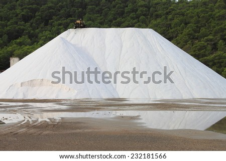 Mountain of salt in a marine salt production site - stock photo