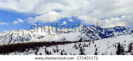 Mountain panorama beautiful winter landscape in Tatra Mountains. Sunny sky with white clouds over panoramic beauty view, Poland - stock photo