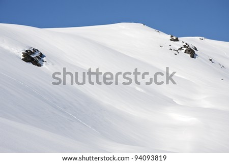 mountain panorama of the snow in a sunny winter day