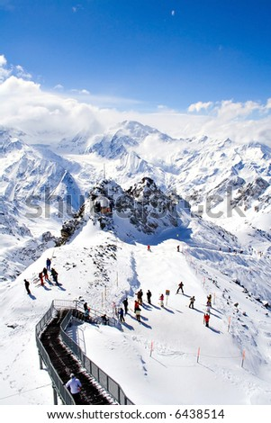 Mountain peak covered with snow - stock photo