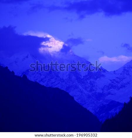 mountain peak in the Annapurna ridge at sunset, Himalayas, Nepal  - stock photo