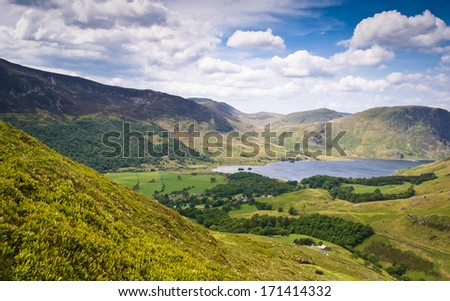 Mountain peaks and blue sky in Eskdale valley, Lake District, UK. - stock photo