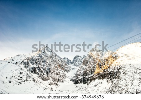 Mountain peaks and cliffs landscape. Winter mountains and panoramic scenic view - stock photo