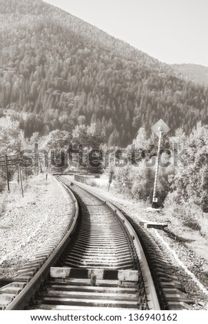 mountain railroad in morning light - stock photo