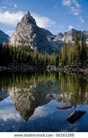 Mountain reflecting in lake - stock photo