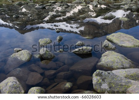 Mountain reflecting in pond in the Pirin range - Bulgarian balkans - stock photo