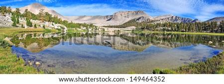 Mountain Reflection in Lake, Sierra Nevada Mountains, California, USA - stock photo
