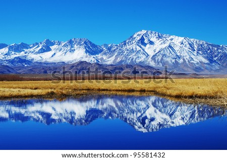 mountain reflection of Mount Tom in the Owens valley - stock photo