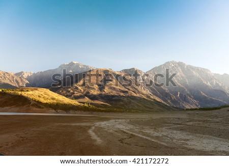 Mountain reflection on lake at sunrise - stock photo