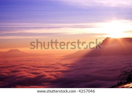 mountain ridge with high cloudness at sunset time. Babugan, Crimea, Ukraine - stock photo