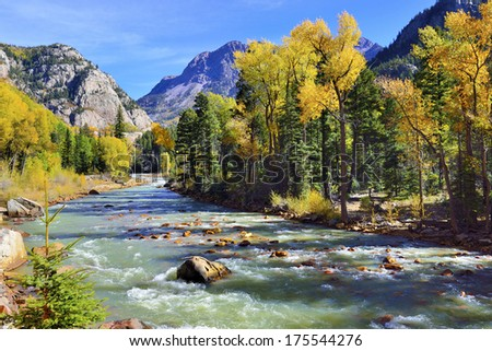 mountain river and colourful mountains of Colorado during foliage season - stock photo