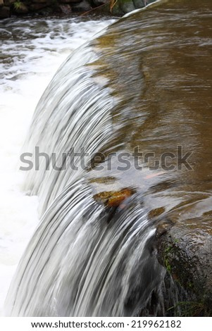 Mountain river background with small waterfalls in tropical forest. - stock photo