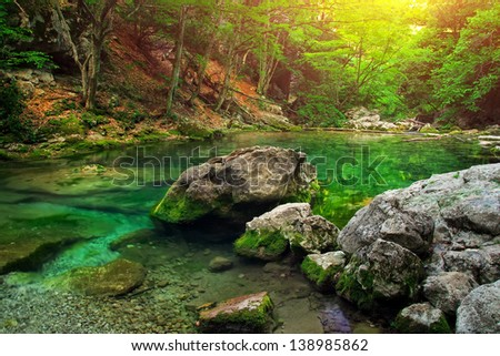 Mountain river in forest and mountain terrain. Crimea, the Grand Canyon - stock photo