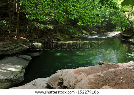 Mountain river with blue green water at  Catskils mountains upstate NY at the summer time. Blue Hall lagune. - stock photo