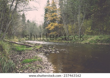 mountain river with rocks and sandstones and reflections - retro, vintage style look