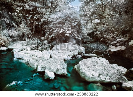 Mountain river with stones infrared (IR) landscape - stock photo