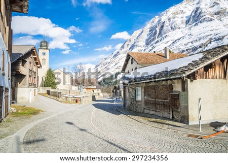 Mountain road in a sunny day (Swiss alps). - stock photo