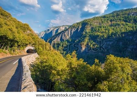 Mountain Road in California Sierra Nevada near Yosemite National Park. California, USA. Mountain Road Tunnel - stock photo