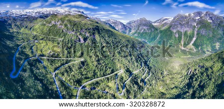 Mountain road in Gaularfjellet mountain pass in Norway surrounded by magnificent mountains - stock photo