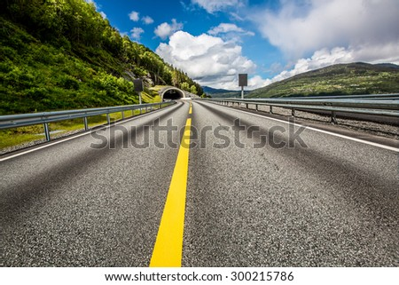 Mountain road in Norway. The entrance to the tunnel. - stock photo
