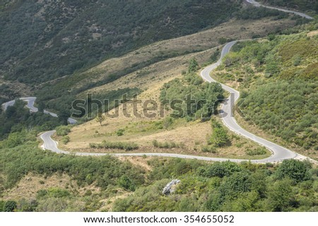 Mountain road in Saliencia Valley, Somiedo Nature Reserve. It is located in the central area of the Cantabrian Mountains in the Principality of Asturias in northern Spain - stock photo