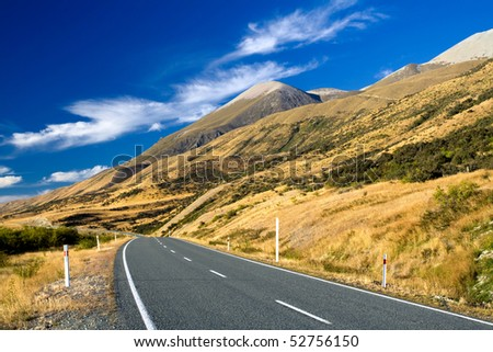 mountain road on clear sunny day of autumn