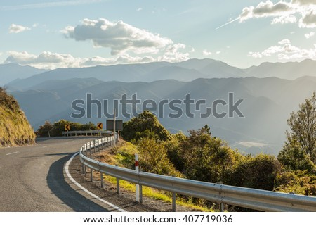 Mountain road through New Zealand with nice sun light