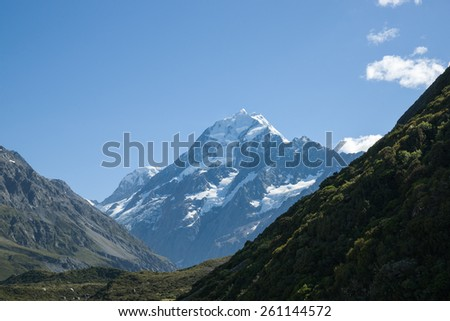 Mountain scenery, silhouette slopes with distant Mount Cook, New Zealand. - stock photo