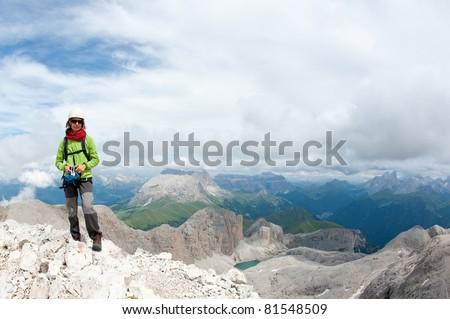 Mountain scenery with rock climber. Dolomites, Italy. Antermoia lake and Sella group in the background. - stock photo