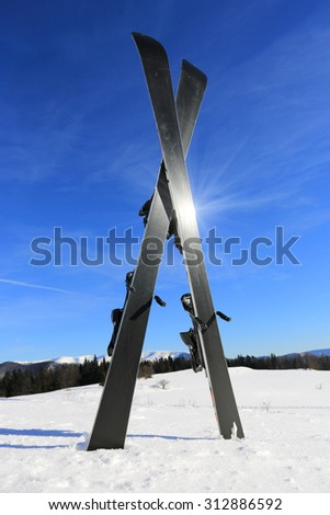 Mountain ski on snow of winter resort - stock photo