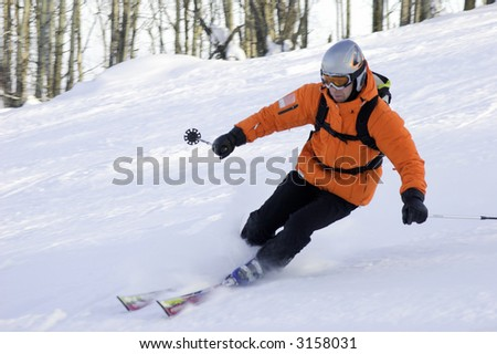 mountain ski rider in orange in Siberia - stock photo