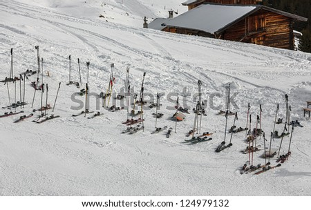 Mountain skiing and sticks lie before restaurant in a ski resort of a valley of Zillertal - Mayrhofen, Austria - stock photo